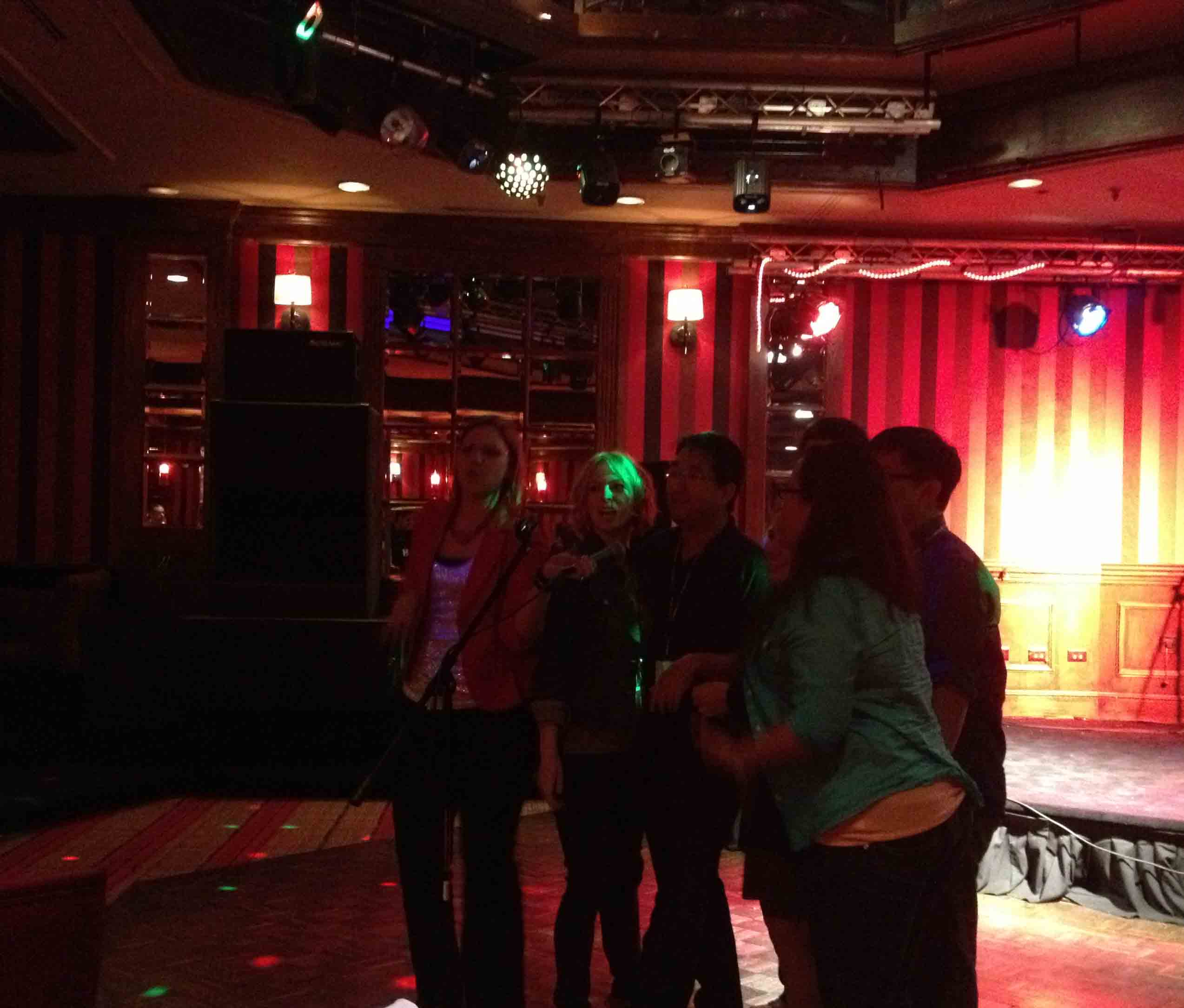 Six people singing at karaoke!