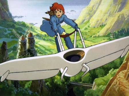 A still from the film 'Nausicaä' of the heroine riding through the sky on glider shaped like a manta ray.