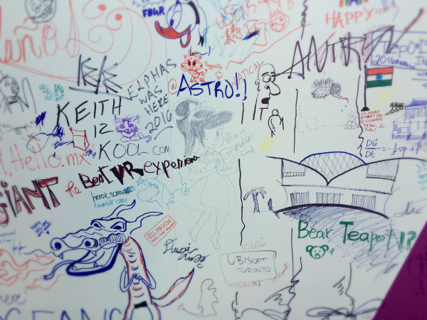 A wall covered in attendees' drawings.