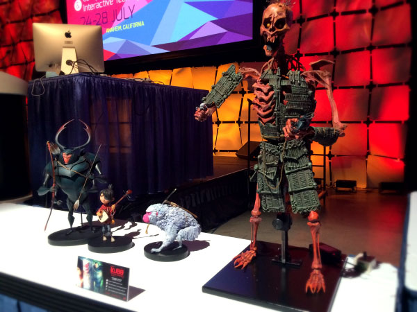 Three puppets from Kubo and the Two Strings on display at a SIGGRAPH panel.