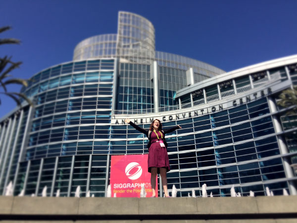 Rachel Nabors striking a victory pose in front of the Anaheim Convention Center.